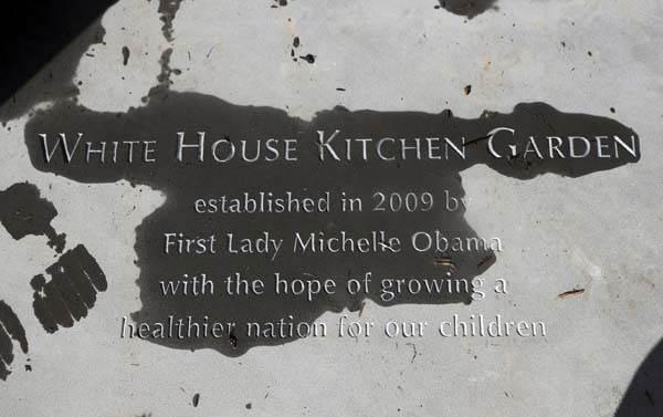 "<div class=""meta image-caption""><div class=""origin-logo origin-image ap""><span>AP</span></div><span class=""caption-text"">A new paver etched with markings ""White House Kitchen Garden"" is seen at the entrance to the White House Kitchen Garden (AP Photo/Manuel Balce Ceneta)</span></div>"