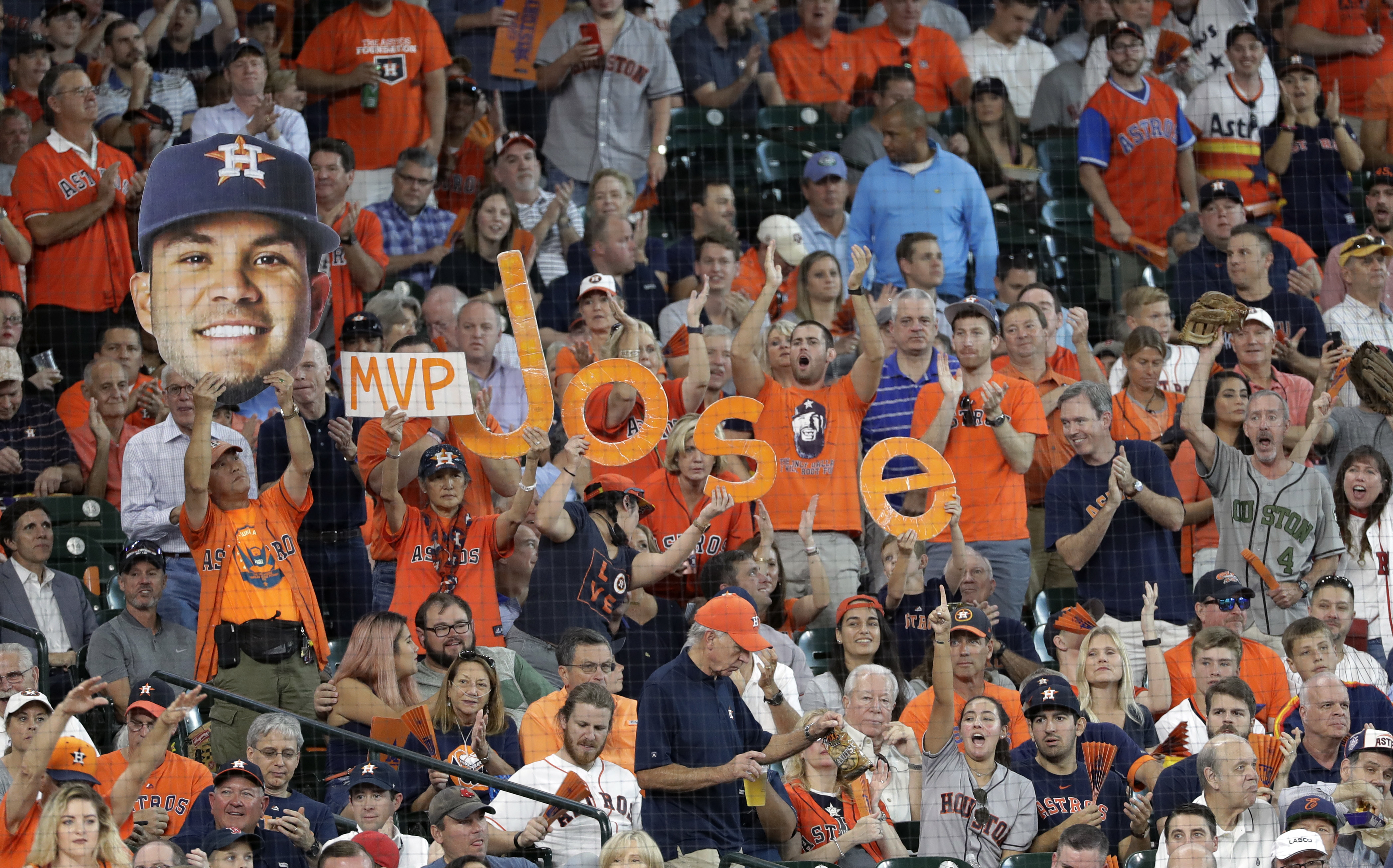 <div class='meta'><div class='origin-logo' data-origin='AP'></div><span class='caption-text' data-credit='David J. Phillip'>Fans cheer for Houston Astros second baseman Jose Altuve (27) during the first inning in Game 2.</span></div>