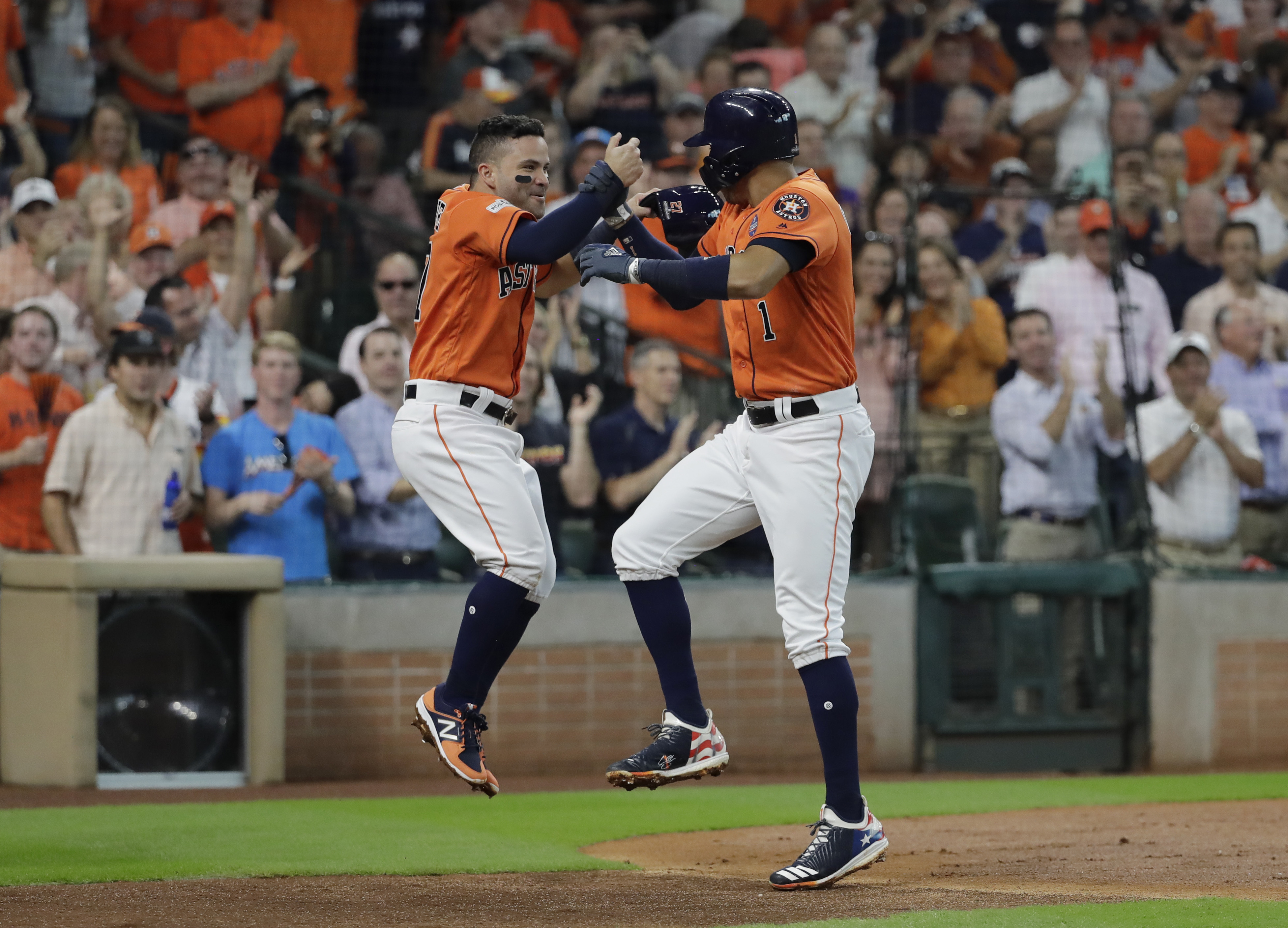<div class='meta'><div class='origin-logo' data-origin='AP'></div><span class='caption-text' data-credit='David J. Phillip'>Houston Astros' Carlos Correa, right, celebrates his two-run home run with teammate Jose Altuve, left, during the first inning in Game 2.</span></div>
