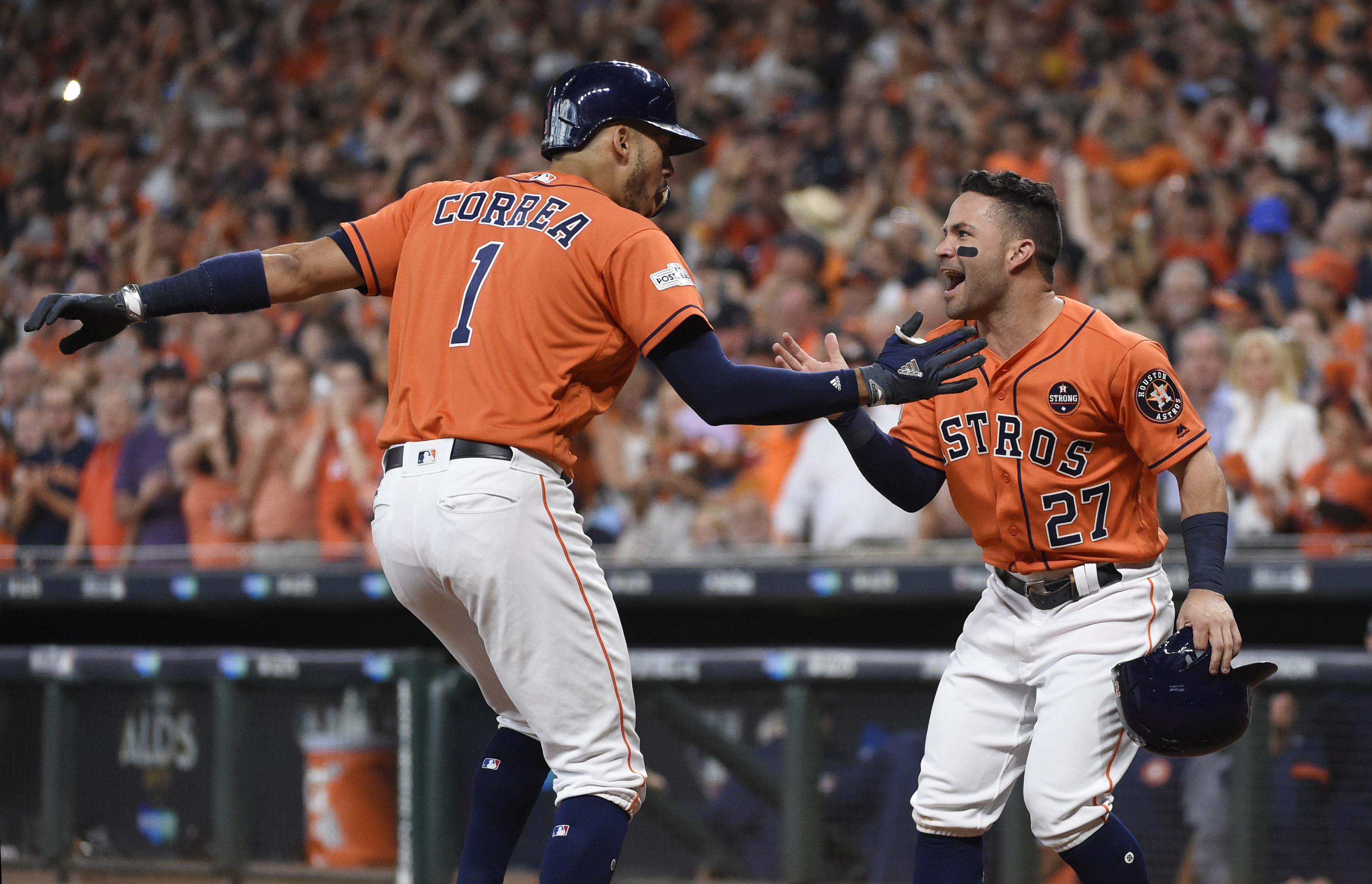 <div class='meta'><div class='origin-logo' data-origin='AP'></div><span class='caption-text' data-credit='Eric Christian Smith'>Houston Astros' Carlos Correa (1) celebrates his two-run home run with teammate Jose Altuve (27) during the first inning in Game 2.</span></div>