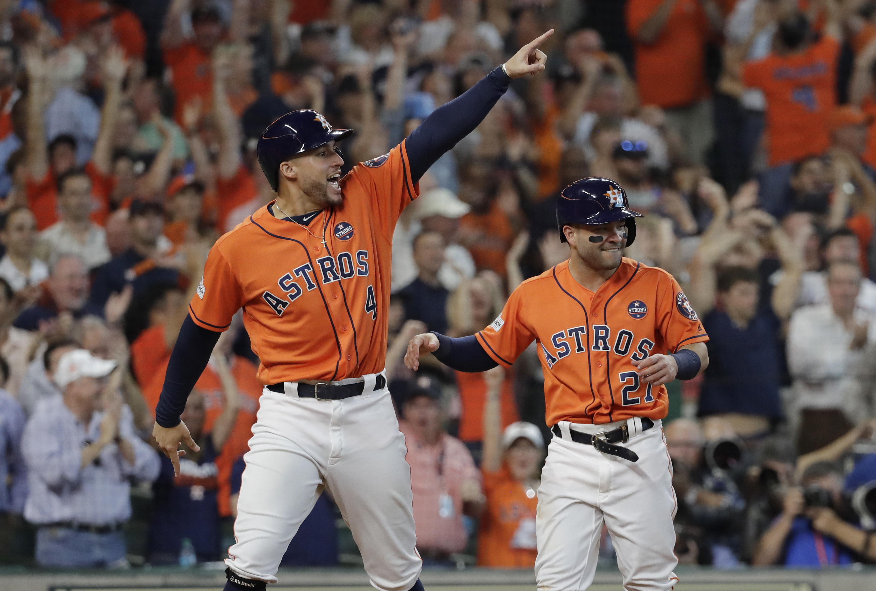 <div class='meta'><div class='origin-logo' data-origin='AP'></div><span class='caption-text' data-credit='David J. Phillip'>Houston Astros' George Springer (4) and Jose Altuve (27) celebrate after they scored on teammate Carlos Correa's double in Game 2.</span></div>