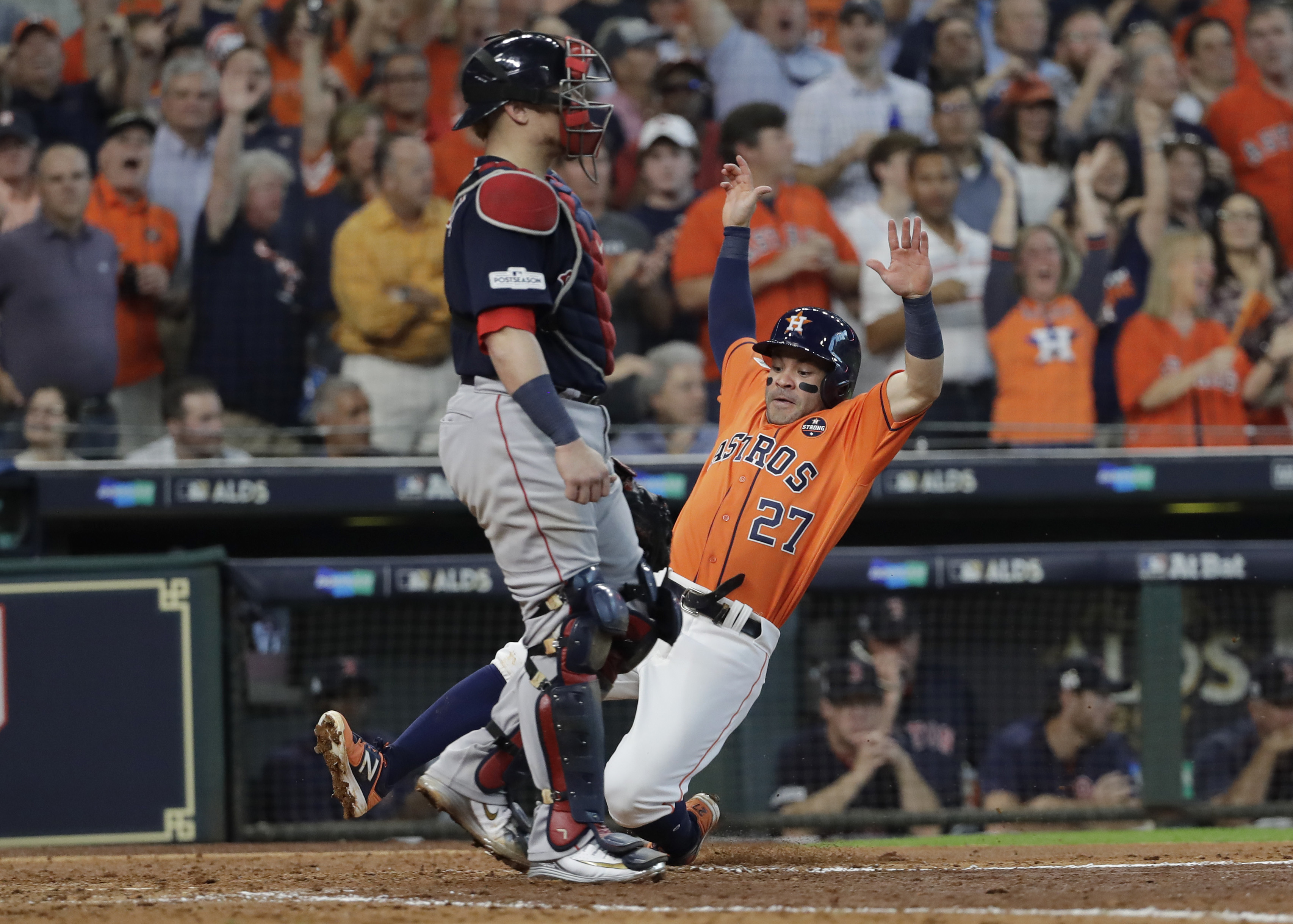 <div class='meta'><div class='origin-logo' data-origin='AP'></div><span class='caption-text' data-credit='David J. Phillip'>Houston Astros' Jose Altuve (27) scores past Boston Red Sox catcher Christian Vazquez (7) on teammate Carlos Correa's double during the sixth inning in Game 2.</span></div>