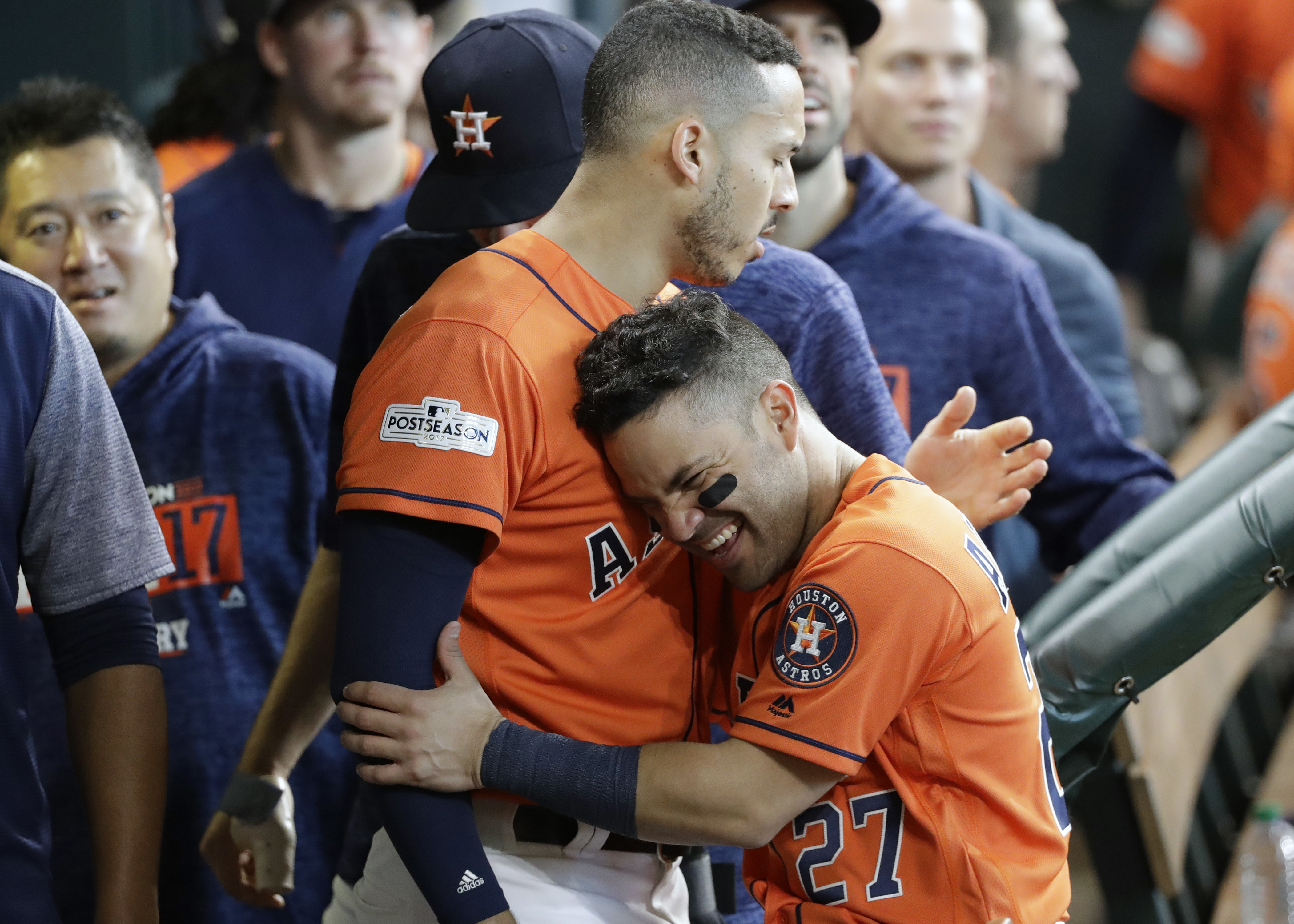 <div class='meta'><div class='origin-logo' data-origin='AP'></div><span class='caption-text' data-credit='David J. Phillip'>Houston Astros' Jose Altuve (27) celebrates with George Springer (4) after they scored on teammate Carlos Correa's double in Game 2.</span></div>