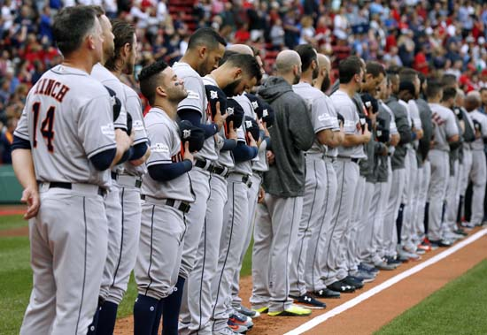 <div class='meta'><div class='origin-logo' data-origin='AP'></div><span class='caption-text' data-credit='AP'>The Houston Astros stand along the third baseline during the national anthem before Game 3. (AP Photo/Michael Dwyer)</span></div>