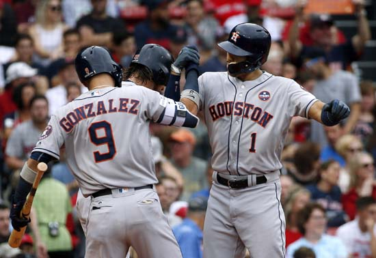 <div class='meta'><div class='origin-logo' data-origin='AP'></div><span class='caption-text' data-credit='Michael Dwyer'>Houston Astros's Carlos Correa, right, celebrates his two-run home run off Boston Red Sox starting pitcher Doug Fister with Marwin Gonzalez (9) and Josh Reddick, partially hidden.</span></div>
