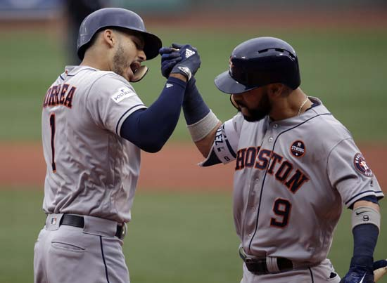 <div class='meta'><div class='origin-logo' data-origin='AP'></div><span class='caption-text' data-credit='Charles Krupa'>Houston Astros shortstop Carlos Correa, left, celebrates his two-run home run with Marwin Gonzalez off Boston Red Sox starting pitcher Doug Fister during the first inning of Game 3</span></div>