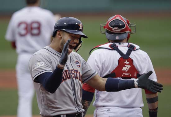 <div class='meta'><div class='origin-logo' data-origin='AP'></div><span class='caption-text' data-credit='Charles Krupa'>Houston Astros shortstop Carlos Correa celebrates his two-run home run off Boston Red Sox starting pitcher Doug Fister, left rear, during the first inning of Game 3</span></div>