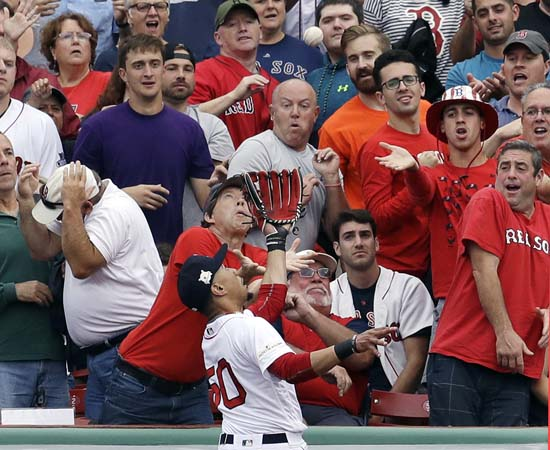 <div class='meta'><div class='origin-logo' data-origin='AP'></div><span class='caption-text' data-credit='AP'>Boston Red Sox right fielder Mookie Betts goes to the wall to catch a fly ball by Houston Astros' Josh Reddick during the second inning of Game 3. (AP Photo/Charles Krupa)</span></div>