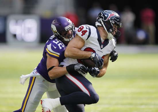 <div class='meta'><div class='origin-logo' data-origin='AP'></div><span class='caption-text' data-credit='Andy Clayton-King'>Houston Texans tight end Ryan Griffin (84) is tackled by Minnesota Vikings outside linebacker Chad Greenway, left, during the first half.</span></div>