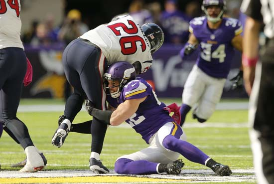 <div class='meta'><div class='origin-logo' data-origin='AP'></div><span class='caption-text' data-credit='Jim Mone'>Minnesota Vikings free safety Harrison Smith tackles Houston Texans running back Lamar Miller (26) during the first half.</span></div>