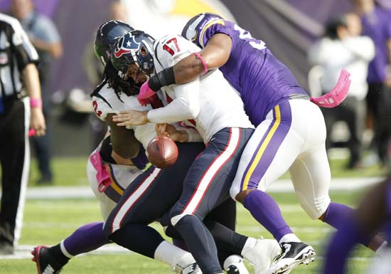 <div class='meta'><div class='origin-logo' data-origin='AP'></div><span class='caption-text' data-credit='Andy Clayton-King'>Houston Texans quarterback Brock Osweiler (17) fumbles as he is sacked by Minnesota Vikings defensive end Everson Griffen, right, during the first half.</span></div>