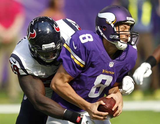 <div class='meta'><div class='origin-logo' data-origin='AP'></div><span class='caption-text' data-credit='Andy Clayton-King'>Minnesota Vikings quarterback Sam Bradford (8) is sacked by Houston Texans outside linebacker Whitney Mercilus, left, during the first half.</span></div>