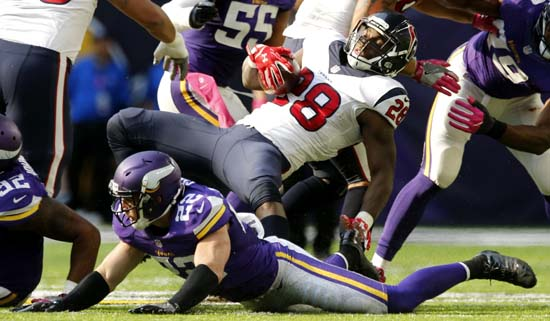 <div class='meta'><div class='origin-logo' data-origin='AP'></div><span class='caption-text' data-credit='Jim Mone'>Houston Texans running back Alfred Blue (28) is tackled by Minnesota Vikings free safety Harrison Smith (22) during the second half.</span></div>