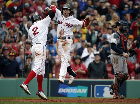 <div class='meta'><div class='origin-logo' data-origin='AP'></div><span class='caption-text' data-credit='AP'>Boston Red Sox's Andrew Benintendi, center, celebrates his two-run home run with Xander Bogaerts, left, during the fifth inning in Game 4.(AP Photo/Michael Dwyer)</span></div>