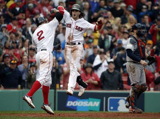 <div class='meta'><div class='origin-logo' data-origin='AP'></div><span class='caption-text' data-credit='AP'>Boston Red Sox's Andrew Benintendi, center, celebrates his two-run home run with Xander Bogaerts, left, during the fifth inning in Game 4.(AP Photo/Michael Dwyer)</span></div>