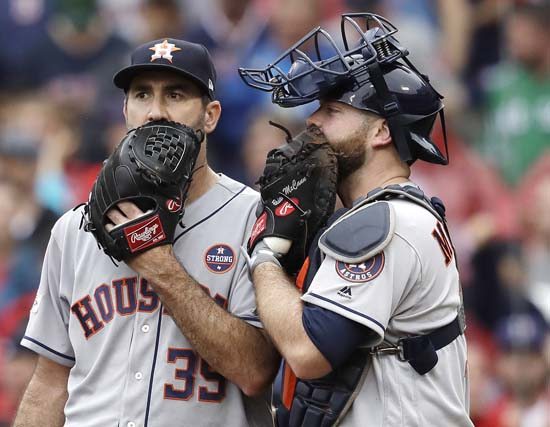 <div class='meta'><div class='origin-logo' data-origin='AP'></div><span class='caption-text' data-credit='AP'>Houston Astros relief pitcher Justin Verlander, left, and catcher Brian McCann talk during the fifth inning of Game 4. (AP Photo/Charles Krupa)</span></div>
