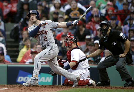 <div class='meta'><div class='origin-logo' data-origin='AP'></div><span class='caption-text' data-credit='AP'>Houston Astros' Alex Bregman (2) watches his home run in front of Boston Red Sox catcher Christian Vazquez during the eighth inning of Game 4. (AP Photo/Charles Krupa)</span></div>