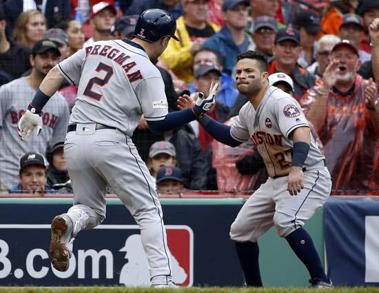 <div class='meta'><div class='origin-logo' data-origin='AP'></div><span class='caption-text' data-credit='AP'>Houston Astros' Alex Bregman celebrates his home run off Boston Red Sox relief pitcher Chris Sale with Jose Altuve, right, during the eighth inning. (AP Photo/Michael Dwyer)</span></div>