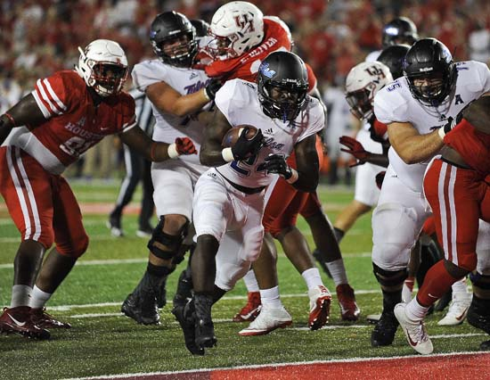 <div class='meta'><div class='origin-logo' data-origin='AP'></div><span class='caption-text' data-credit='Eric Christian Smith'>Tulsa running back Corey Taylor II, center, runs into the end zone for a touchdown in the first half of an NCAA college football game against Houston.</span></div>