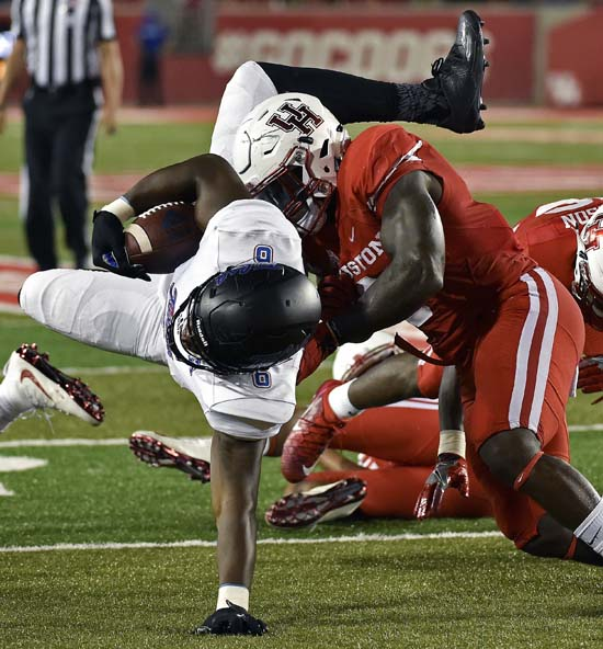 <div class='meta'><div class='origin-logo' data-origin='AP'></div><span class='caption-text' data-credit='Eric Christian Smith'>Tulsa tight end Chris Minter, left, is tackled by Houston linebacker Matthew Adams in the first half of an NCAA college football game, Saturday, Oct. 15, 2016, in Houston.</span></div>