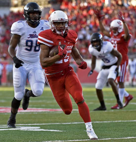 <div class='meta'><div class='origin-logo' data-origin='AP'></div><span class='caption-text' data-credit='Eric Christian Smith'>Houston running back Dillon Birden, center, scampers past Tulsa defensive end Jeremy Smith for a 17-yard touchdown in the first half.</span></div>