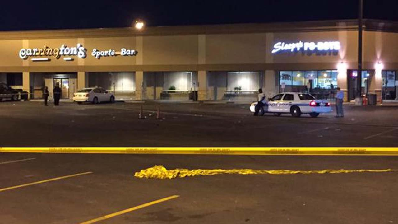 Police outside a sports bar in southwest Houston following a fatal shooting