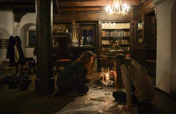 <div class='meta'><div class='origin-logo' data-origin='AP'></div><span class='caption-text' data-credit='AP Photo/Andreea Alexandru'>Two girls light up candles before a photo shoot in Bran Castle, in Bran, Romania</span></div>