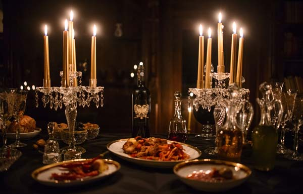 <div class='meta'><div class='origin-logo' data-origin='AP'></div><span class='caption-text' data-credit='AP'>A candlelight dinner is set up before a photo shoot, in Bran Castle, in Bran, Romania.</span></div>