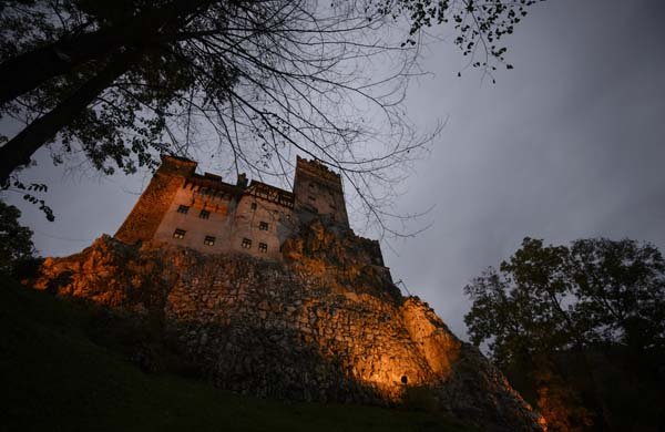 <div class='meta'><div class='origin-logo' data-origin='AP'></div><span class='caption-text' data-credit='AP Photo/Andreea Alexandru'>Bran Castle lies on top of cliffs in Bran, Romania.</span></div>