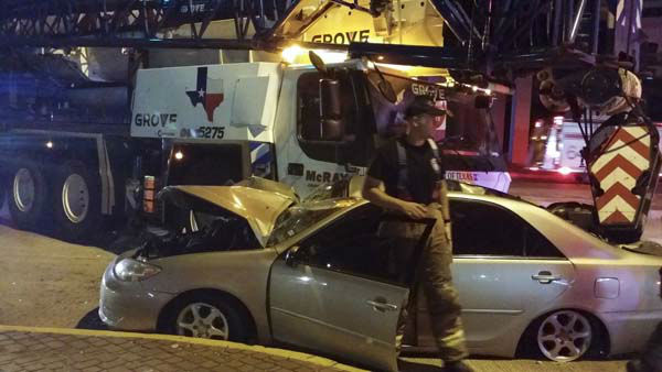 Car badly damaged after accident with crane for Abc motor credit gilchrist rd