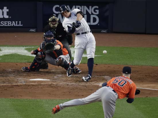 <div class='meta'><div class='origin-logo' data-origin='AP'></div><span class='caption-text' data-credit='Frank Franklin II'>New York Yankees' Aaron Judge hits an RBI double during the third inning of Game 5 of baseball's American League Championship Series.</span></div>