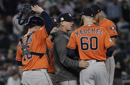 <div class='meta'><div class='origin-logo' data-origin='AP'></div><span class='caption-text' data-credit='David J. Phillip'>Houston Astros manager A.J. Hinch talks to starting pitcher Dallas Keuchel during the fifth inning of Game 5 of baseball's American League Championship Series.</span></div>