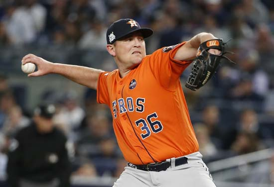 <div class='meta'><div class='origin-logo' data-origin='AP'></div><span class='caption-text' data-credit='Kathy Willens'>Houston Astros relief pitcher Will Harris throws during the sixth inning of Game 5 of baseball's American League Championship Series.</span></div>