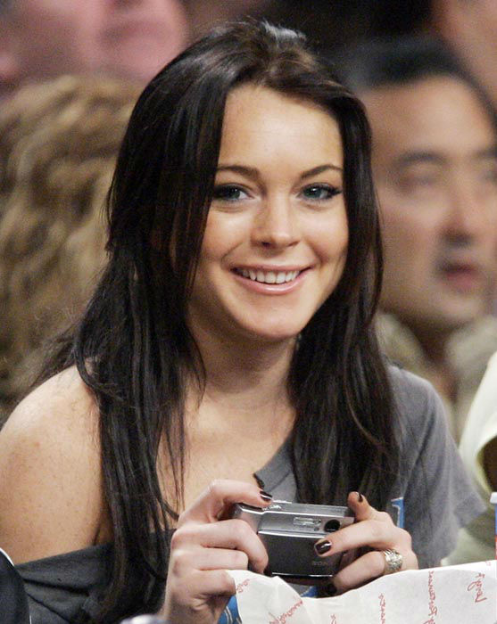 """<div class=""""meta image-caption""""><div class=""""origin-logo origin-image none""""><span>none</span></div><span class=""""caption-text"""">Actress Lindsay Lohan smiles at the camera as she watches the Los Angeles Lakers play the Atlanta Hawks in an NBA basketball game, last Friday night, Dec. 8, 2006. (AP Photo/ MARK J. TERRILL)</span></div>"""