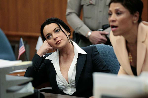 """<div class=""""meta image-caption""""><div class=""""origin-logo origin-image none""""><span>none</span></div><span class=""""caption-text"""">Actress Lindsay Lohan, left, is shown in court with her attorney Shawn Chapman Holley during a hearing in Beverly Hills, Calif., Monday, May 24, 2010. (AP Photo/ Jae C. Hong)</span></div>"""