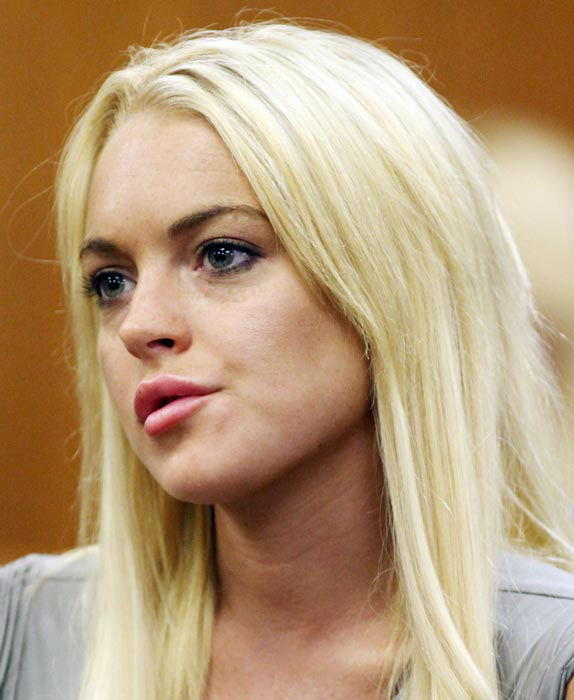 "<div class=""meta image-caption""><div class=""origin-logo origin-image none""><span>none</span></div><span class=""caption-text"">Lindsay Lohan is shown in a court, Tuesday, July 20, 2010, in Beverly Hills, Calif., where she was taken into custody to serve a jail sentence for probation violation. (AP Photo/ Al Seib)</span></div>"