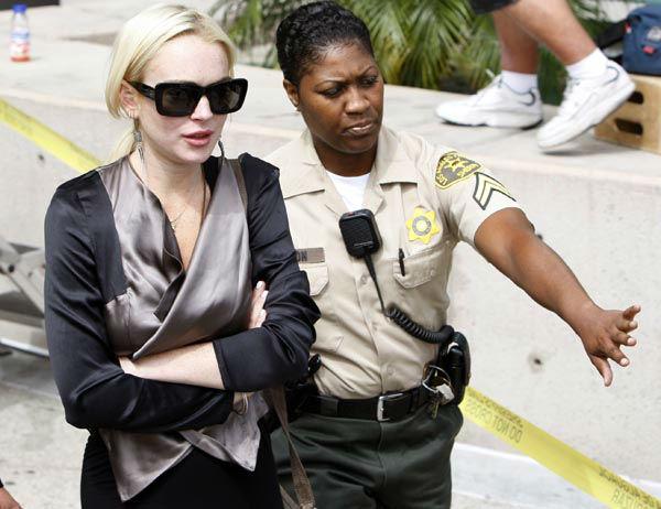 "<div class=""meta image-caption""><div class=""origin-logo origin-image none""><span>none</span></div><span class=""caption-text"">Lindsay Lohan exits a case review conference in Los Angeles, Thursday, July 21, 2011.  (AP Photo/ Nick Ut)</span></div>"