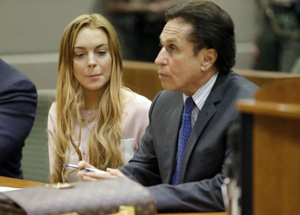 "<div class=""meta image-caption""><div class=""origin-logo origin-image none""><span>none</span></div><span class=""caption-text"">Actress Lindsay Lohan, attorney Mark Heller, at a hearing in Los Angeles Superior Court Monday, March 18, 2013.  (AP Photo/ Reed Saxon)</span></div>"