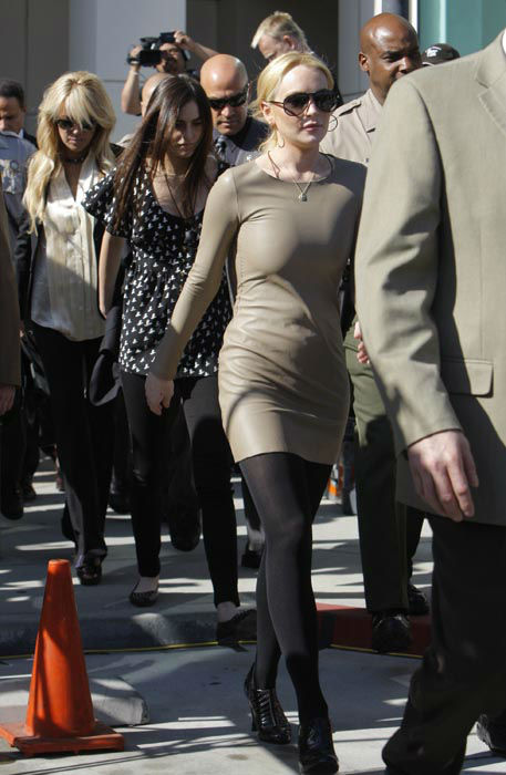 "<div class=""meta image-caption""><div class=""origin-logo origin-image none""><span>none</span></div><span class=""caption-text"">Lindsay Lohan leaves Los Angeles Superior Court, Thursday, March 10, 2011, followed by her mother, Dina, far left, and sister, Ali, second from left.  (AP Photo/ Damian Dovarganes)</span></div>"