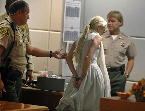 "<div class=""meta image-caption""><div class=""origin-logo origin-image none""><span>none</span></div><span class=""caption-text"">Lindsay Lohan is taken into custody by Los Angeles Country sheriffs after a judge finds her in violation of probation Wednesday, Oct. 19, 2011, in Los Angeles. (AP Photo/ Mark Boster)</span></div>"