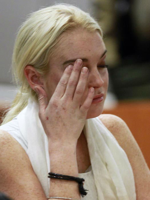 "<div class=""meta image-caption""><div class=""origin-logo origin-image none""><span>none</span></div><span class=""caption-text"">Lindsay Lohan is shown in court before being taken into custody by Los Angeles Country sheriffs deputies after a judge found her in violation of probation Wednesday, Oct. 19, 2011. (AP Photo/ Mark Boster)</span></div>"