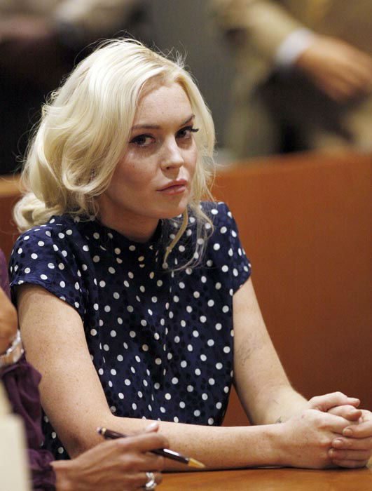"""<div class=""""meta image-caption""""><div class=""""origin-logo origin-image none""""><span>none</span></div><span class=""""caption-text"""">In this Nov. 2, 2011 file photo, actress Lindsay Lohan appears for a probation hearing in Los Angeles Superior Court.  (AP Photo/ Mario Anzuoni)</span></div>"""