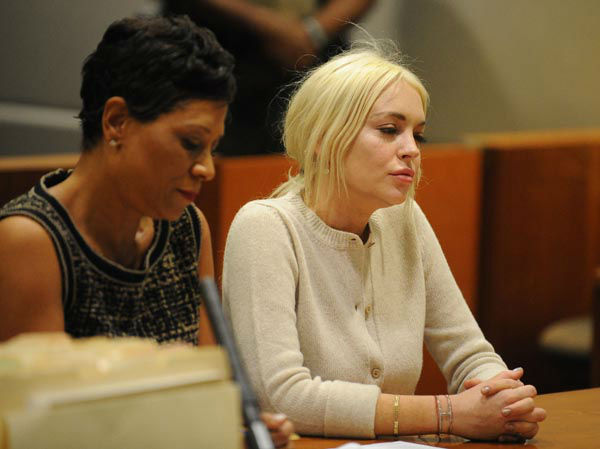"<div class=""meta image-caption""><div class=""origin-logo origin-image none""><span>none</span></div><span class=""caption-text"">Lindsay Lohan appears in court during progress report session at the Los Angeles Superior Court Wednesday, Dec. 14, 2011 in Los Angeles. (AP Photo/ Michael Nelson)</span></div>"