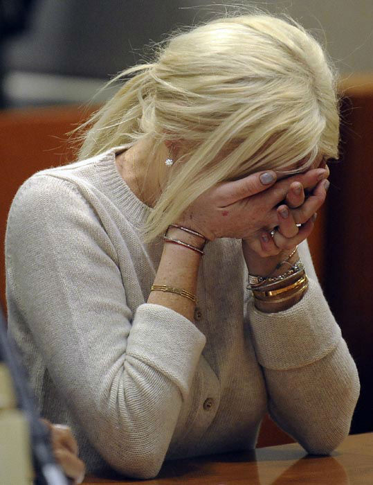 """<div class=""""meta image-caption""""><div class=""""origin-logo origin-image none""""><span>none</span></div><span class=""""caption-text"""">Lindsay Lohan, right, alongside her attorney Shawn Chapman Holley are seen during progress report session at the Los Angeles Superior Court Wednesday, Dec. 14, 2011. (AP Photo/ Michael Nelson)</span></div>"""