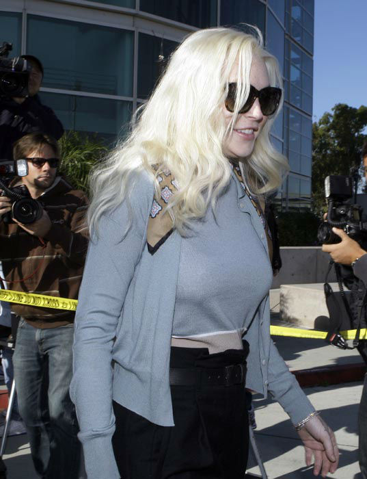 "<div class=""meta image-caption""><div class=""origin-logo origin-image none""><span>none</span></div><span class=""caption-text"">Lindsay Lohan leaves Los Angeles Superior Court after a probation progress hearing Tuesday, Jan. 17, 2012.  (AP Photo/ Reed Saxon)</span></div>"