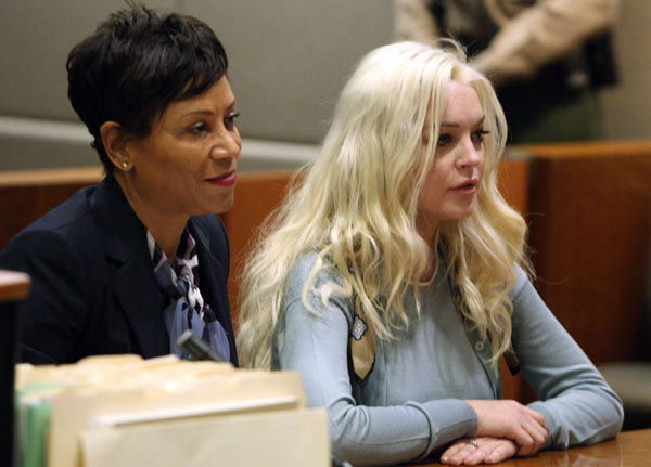 "<div class=""meta image-caption""><div class=""origin-logo origin-image none""><span>none</span></div><span class=""caption-text"">Lindsay Lohan, right, appears with her attorney Shawn Chapman Holley in Los Angeles Superior Court for a probation progress hearing Tuesday, Jan. 17, 2012. (AP Photo/ Gary Friedman)</span></div>"