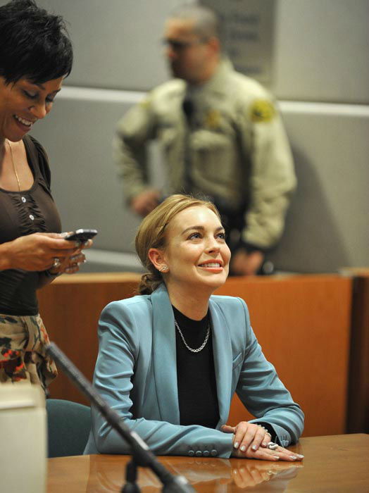 "<div class=""meta image-caption""><div class=""origin-logo origin-image none""><span>none</span></div><span class=""caption-text"">Lindsay Lohan smiles during a progress report on her probation for theft charges at Los Angeles Superior Court Thursday, March 29, 2012. (AP Photo/ Joe Klamar)</span></div>"