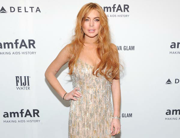 "<div class=""meta image-caption""><div class=""origin-logo origin-image none""><span>none</span></div><span class=""caption-text"">This Feb. 6, 2013 file photo shows actress Lindsay Lohan attending amfAR's New York gala at Cipriani Wall Street in New York.  (AP Photo/ Evan Agostini)</span></div>"