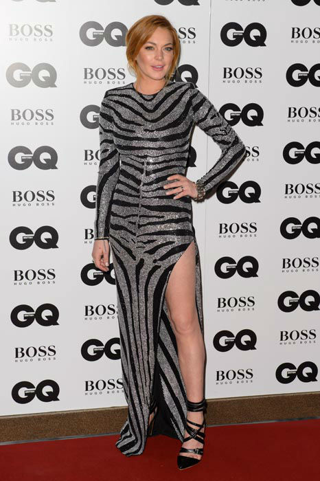 """<div class=""""meta image-caption""""><div class=""""origin-logo origin-image none""""><span>none</span></div><span class=""""caption-text"""">Lindsay Lohan arrives for the GQ Men Of The Year Awards 2014 at a central London venue, London, Tuesday, Sept. 2, 2014. (AP Photo/ Jonathan Short)</span></div>"""