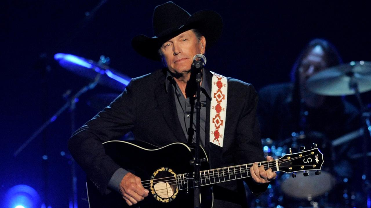 This April 7, 2013 file photo shows George Strait performing at the 48th Annual Academy of Country Music Awards at the MGM Grand Garden Arena in Las Vegas.Chris Pizzello/Invision/AP
